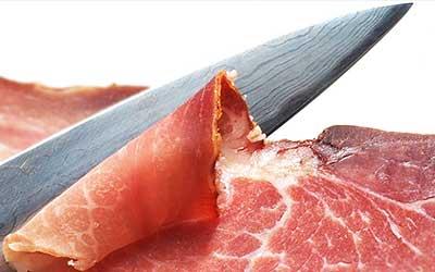 knife cutting ham.
