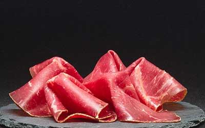 slices of ham on slate stone