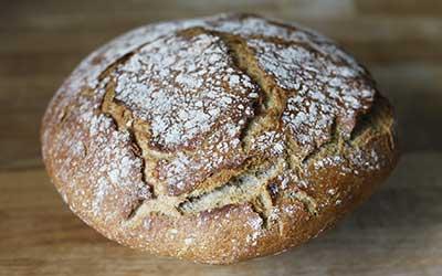 categoria pane senza glutine, si vede un pane tondo rustico.